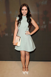 Lily Collins paired her dress with an oversized two-tone clutch, also by Marni.