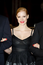 Jessica Chastain coordinated her vibrant classic red lips with glossy scarlet nails at the 2011 Marrakech International Film Festival.