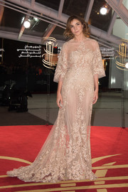 Clotilde Courau looked regal on the Marrakech International Film Festival red carpet in an embroidered nude gown by Elie Saab.