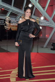 Marie Gillain was edgy-glam at the Marrakech International Film Festival in a long-sleeve black evening dress with exposed shoulders.