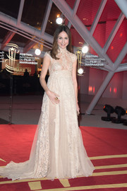 Elsa Zylberstein looked breathtaking at the Marrakech International Film Festival in a nude Zuhair Murad empire gown with a high neck and cap sleeves.