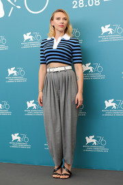 Scarlett Johansson teamed her top with slouchy gray slacks, also by Michael Kors.
