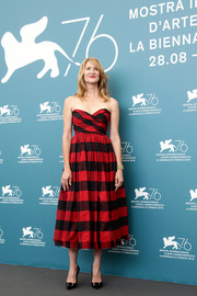 Laura Dern looked effortlessly stylish in a strapless, striped midi dress by Dior at the Venice Film Festival photocall for 'Marriage Story.'