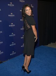 Rosario Dawson went for simple elegance with this little black dress, made more interesting with lacy back detail, during the Martell Caractere launch.