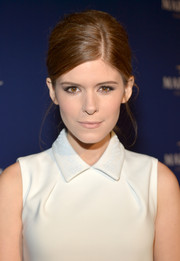 Kate Mara wore her hair in a retro-glam French twist when she attended the Martell Caractere launch.