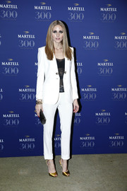 Olivia Palermo kept it sleek and chic all the way down to her gold satin slingback peep-toes.