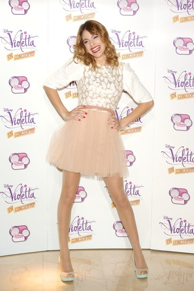 Martina Stoessel Cocktail Dress [violetta,madrid photocall,clothing,fashion model,cocktail dress,fashion,footwear,dress,hairstyle,pink,leg,long hair,martina stoessel,emperador hotel,madrid,spain,photocall]