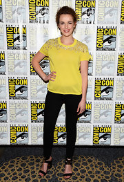 A canary yellow top with and embellished neckline and sleeves was a cheerful choice for Elizabeth.