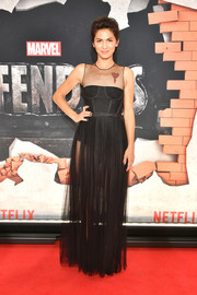Elodie Yung went for a sheer black corset gown by Christian Dior at the New York premiere of 'The Defenders.'