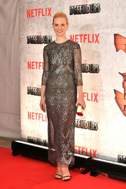 Deborah Ann Woll rounded out her look with a geometric gold clutch.