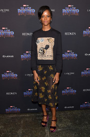Letitia Wright rounded out her look with a pair of purple platforms.