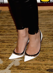 Emily VanCamp's pointy-toed patent leather pumps added a stark contrast to Emily's all-black look.
