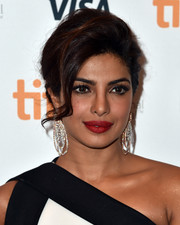 Priyanka Chopra paired her updo with crystal chandelier earrings for total glamour.