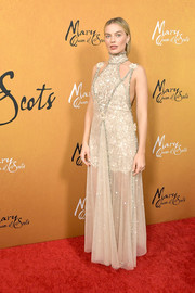 Margot Robbie looked like an angel in a nude Chanel Couture lace dress with a sheer overlay at the New York premiere of 'Mary Queen of Scots.'