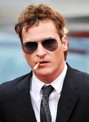 Joaquin Phoenix looked like a bad boy behind his classic Ray-Ban aviators.