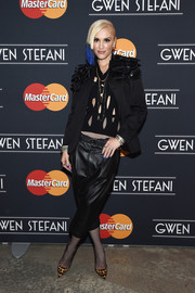 Gwen Stefani showed her unique sense of style with this black blazer adorned with layers of leather bows as she arrived for her MasterCard concert.