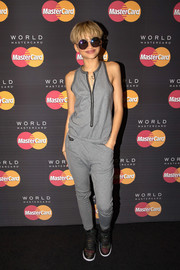 Zendaya Coleman kept it relaxed in a sporty gray zip-front jumpsuit while attending a MasterCard event.