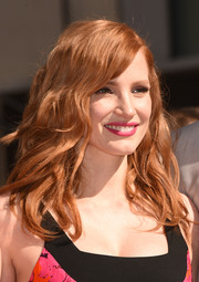 Jessica Chastain topped off her look with a bold pink lip.