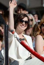 Anne Hathaway accessorized with stylish tortoiseshell sunglasses during Matthew McConaughey's Walk of Fame ceremony.