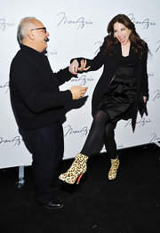 Lynn danced with Max Azria in a black evening coat over a satin LBD.