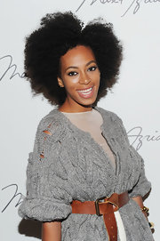 Solange rocked her natural tresses in a coiled Afro.