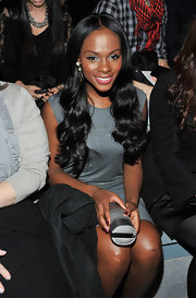 Tika Sumpter looked modern at the Max Azria fashion show in a studded gray dress teamed with a silver tube clutch.