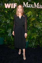 Debby Ryan looked sharp in a black tux dress with a pleated skirt and sheer sleeves at the Max Mara WIF Face of the Future event.