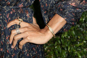 Daniella Alonso added a touch of gold to her look with a Spartina 449 bracelet.