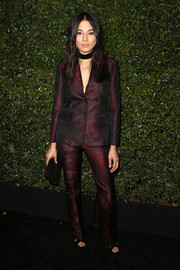 Jessica Gomes went for mannish elegance in a sleek burgundy pantsuit by Max Mara during the Face of the Future event.
