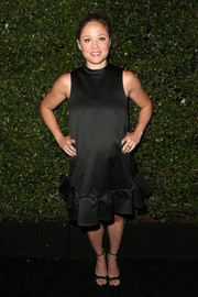 Erika Christensen complemented her maternity dress with stylish black ankle-strap heels.