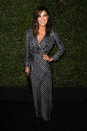 Jessica Szohr chose a floor-length black-and-white faux-wrap dress for the Max Mara Face of the Future event.