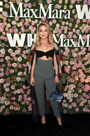For her bag, Olivia Holt chose a blue velvet purse with a gold chain strap.