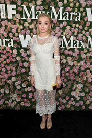 Peyton List had a bridal moment at the 2017 Face of the Future event in a white lace dress by Burberry.