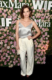 Lauren Cohan finished off her outfit with a pair of slouchy ivory trousers, also by Max Mara.