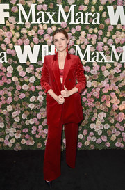 Zoey Deutch worked an oversized red velvet pantsuit by Max Mara at the 2017 Face of the Future event.