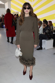 A cute crescent-shaped leather purse rounded out Eleonora Carisi's ensemble.