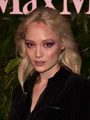 Pom Klementieff looked striking with her heavy, multicolored eyeshadow.