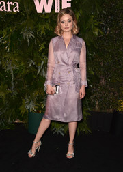 Bella Heathcote polished off her look with a pair of embellished silver sandals.