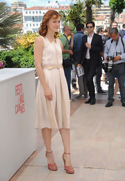 Kerry Bishe's nude and white pleated dress was light, airy, and summery at Cannes.