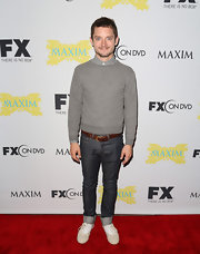 Elijah Wood completed his outfit at the Fox Entertainment Party by wearing a pair of white lace-up sneakers.