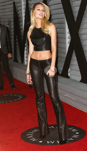 Candice Swanepoel topped off her fierce ensemble with a studded oval clutch by Christian Louboutin.
