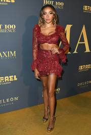 Tinashe flaunted her abs in a flirty red crop-top by Raisa & Vanessa at the Maxim Hot 100 Experience.