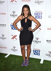Angela Simmons rocked a halter cutout black dress for her sleek and sophisticated look at the Maxim Hot 100 Party.