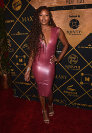 Eva Marcille completed her outfit with basic nude ankle-strap sandals.