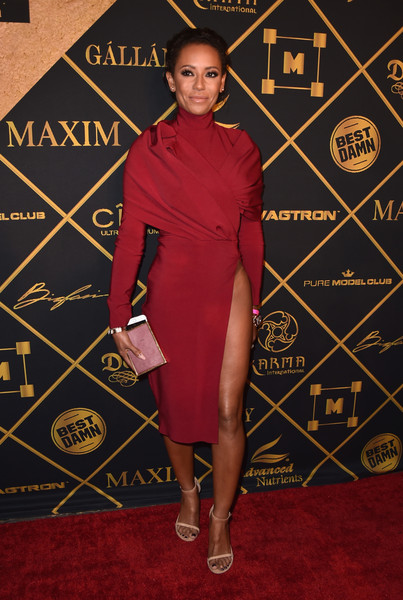 Melanie Brown looked dangerously close to a wardrobe malfunction in a red dress with a crotch-grazing slit during the Maxim Hot 100 Party.