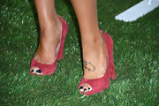 Sharna Burgess chose this pair of burgundy wedges to add some color to her evening look.