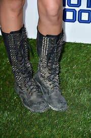 Caroline D'Amore added some major biker-edge to her look with this pair of studded distressed boots.
