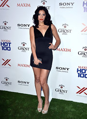 Miranda Rae Mayo rocked a navy and black frock with an embellished bust and bandage-style skirt.
