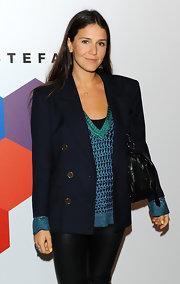 Margherita polished off a sleek ensemble by throwing on a classic navy pea coat.