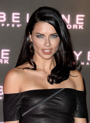 Adriana Lima wore her hair in a side-parted style with curly ends at the Maybelline Bring on the Night party.